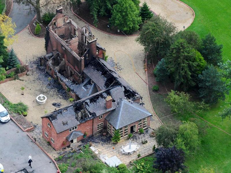 The Shropshire estate at which in 2008 a millionaire with business problems murdered his wife and daughter before shooting dead their dogs and horses, setting fire to the house, and finally killing himself (PA)