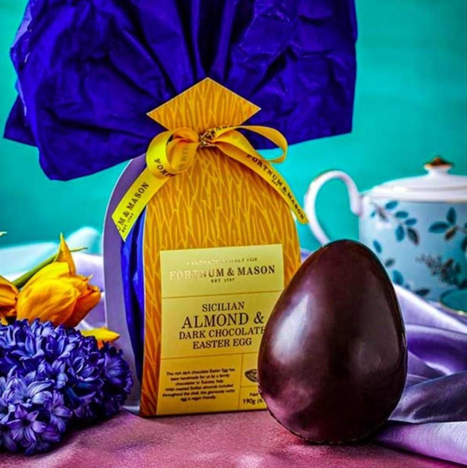 """<p>Splash out on this handmade egg from upmarket food retailer Fortnum & Mason. The dark chocolate shell has sliced almonds throughout, and promises a """"rich, nutty and incredibly moreish"""" flavour. We're sold.</p><p>Almond and dark chocolate nut egg, £29.99, Fortnum & Mason</p><p><a class=""""link rapid-noclick-resp"""" href=""""https://go.redirectingat.com?id=127X1599956&url=https%3A%2F%2Fwww.fortnumandmason.com%2Fproducts%2Falmond-dark-chocolate-nut-egg%3Fchannel%3Dppc%26gclid%3DEAIaIQobChMIqP6p7_vq4AIVDxgMCh3wLQg4EAQYASABEgLHdvD_BwE%26gclsrc%3Daw.ds&sref=https%3A%2F%2Fwww.cosmopolitan.com%2Fuk%2Fworklife%2Fg15871251%2Fvegan-easter-eggs%2F"""" rel=""""nofollow noopener"""" target=""""_blank"""" data-ylk=""""slk:BUY NOW"""">BUY NOW</a></p>"""