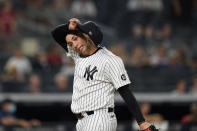 New York Yankees relief pitcher Luis Cessa (85) reacts coming off the mound after allowing a go-ahead, two-run single to Boston Red Sox's Xander Bogaerts in the 10th inning of a baseball game, Sunday, June 6, 2021, at Yankee Stadium in New York. The Red Sox defeated the Yankees 6-5 in 10 innings. (AP Photo/Kathy Willens)