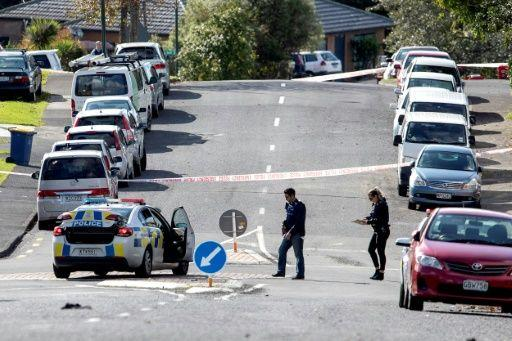 Police officers cordon off an area after the fatal shooting. Source: AFP