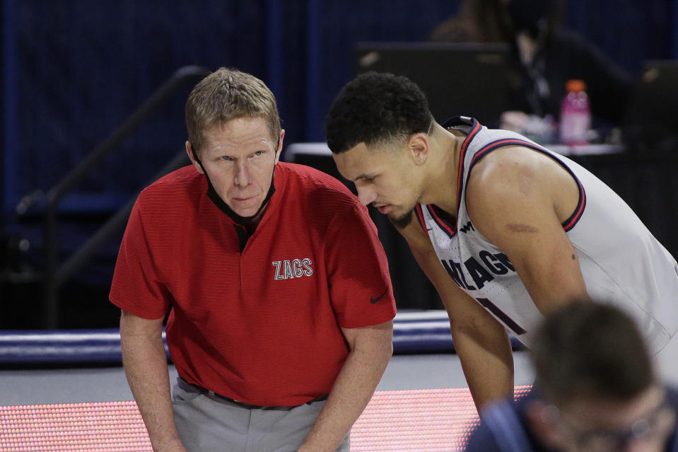 Gonzaga coach Mark Few, left, speaks with guard Jalen Suggs during the second half of the team's NCAA college basketball game against San Diego in Spokane, Wash., Saturday, Feb. 20, 2021. (AP Photo/Young Kwak)