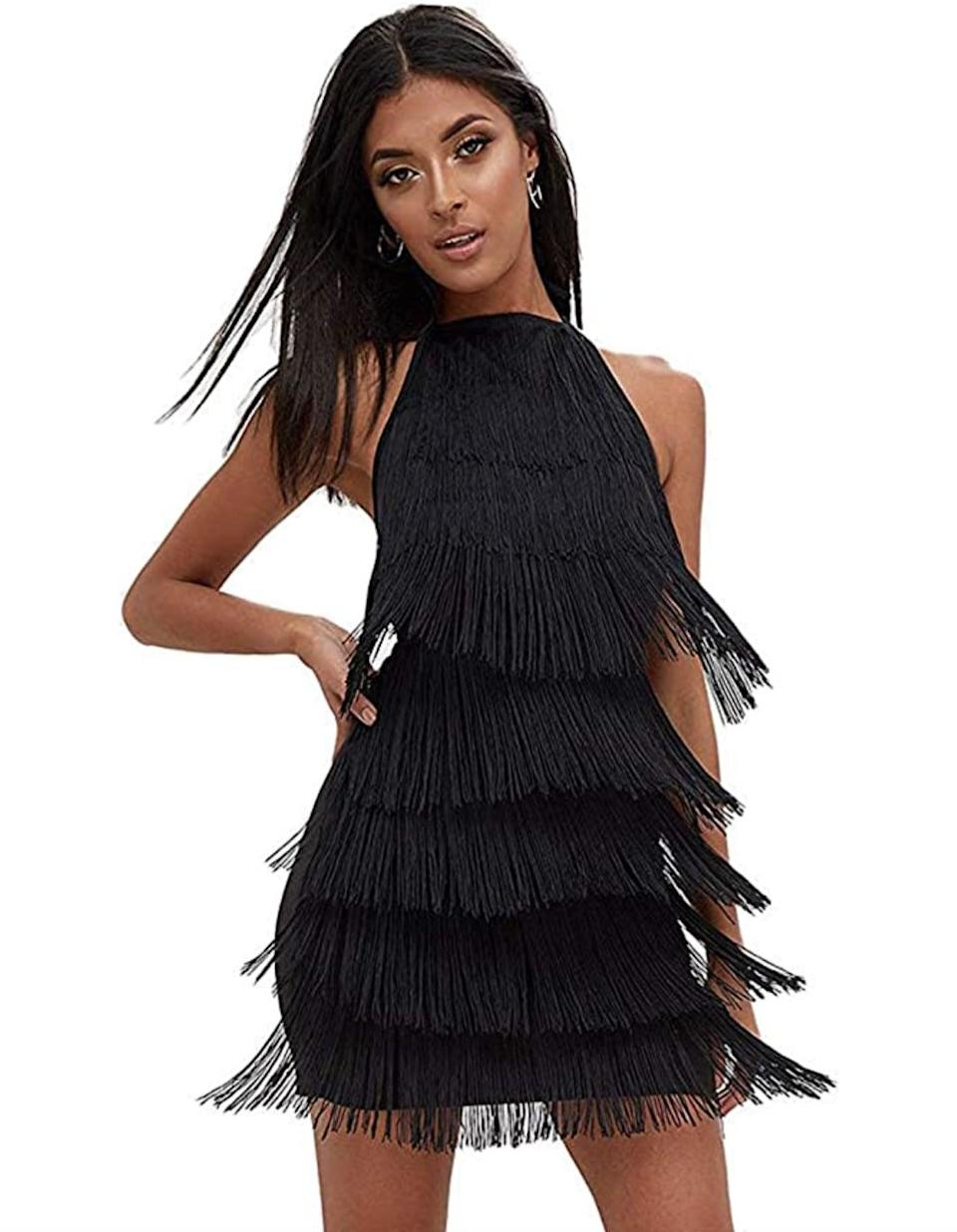 <p>Everyone will want to know where this retro and glam <span>L'VOW Tassels Strap Dress</span> ($30-$32) is from. Save it for the next themed party, and watch the compliments roll in.</p>