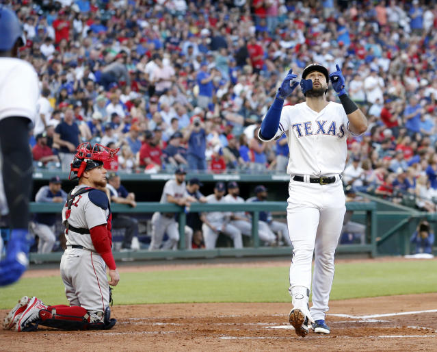 Boston Red Sox catcher Christian Vazquez (7) watches as Texas Rangers' Joey Gallo, right, crosses home after his solo home run during the second inning of a baseball game Saturday, May 5, 2018, in Arlington, Texas. (AP Photo/Michael Ainsworth)
