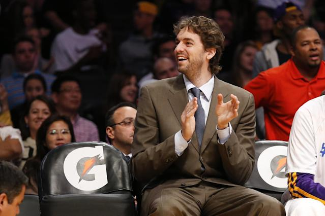 Los Angeles Lakers' Pau Gasol of Spain, who is injured, smiles on the bench against the Utah Jazz during the second half of an NBA basketball game in Los Angeles, Tuesday, Feb. 11, 2014. The Jazz won 96-79. (AP Photo/Danny Moloshok)