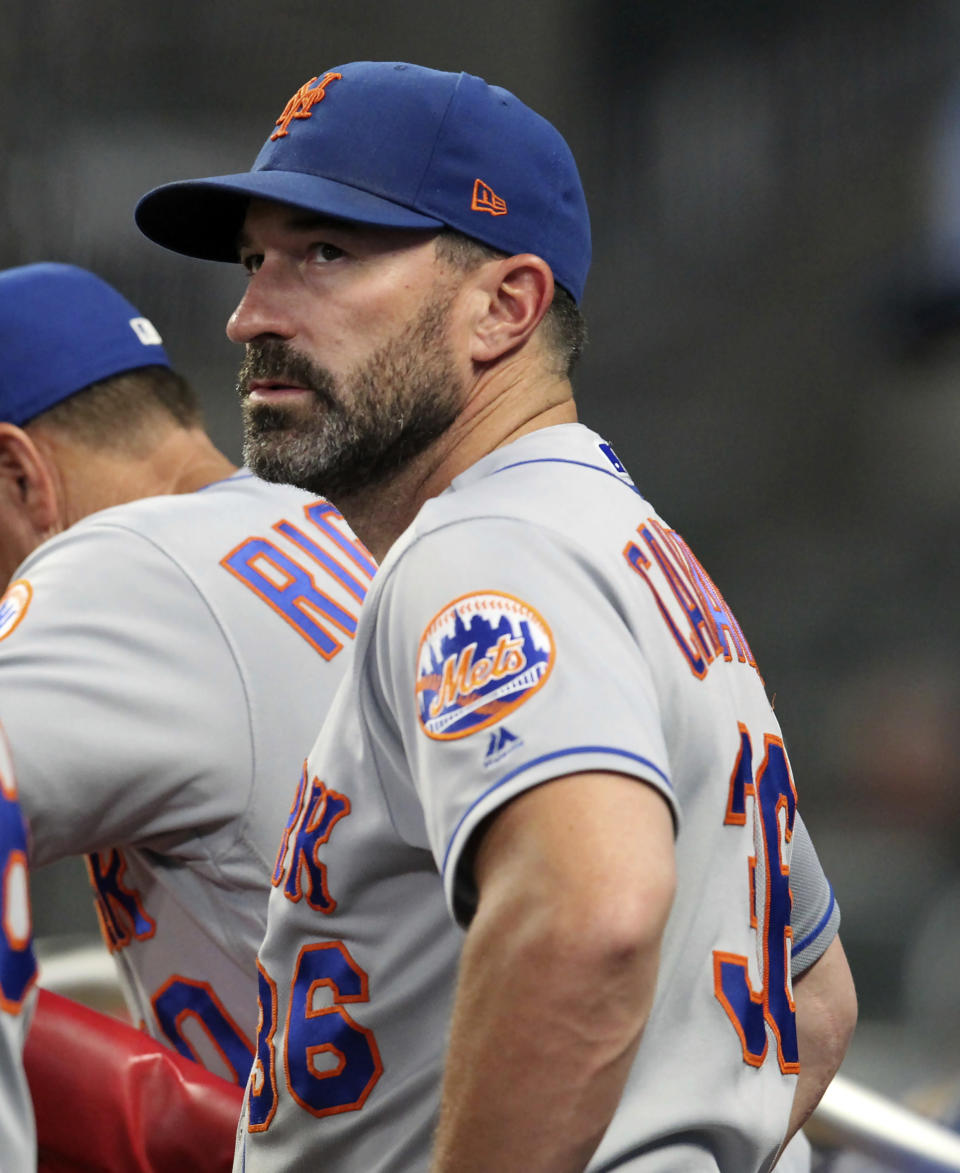 """FILE - In this Thursday, Aug. 15, 2019, file photo, then-New York Mets manager Mickey Callaway watches during the eighth inning of a baseball game against the Atlanta Braves, in Atlanta. Callaway, former manager of the New York Mets and current Los Angeles Angels pitching coach, """"aggressively pursued"""" several women who work in sports media and sent three of them inappropriate photos, The Athletic reported Monday, Feb. 1, 2021. (AP Photo/Tami Chappell, File)"""