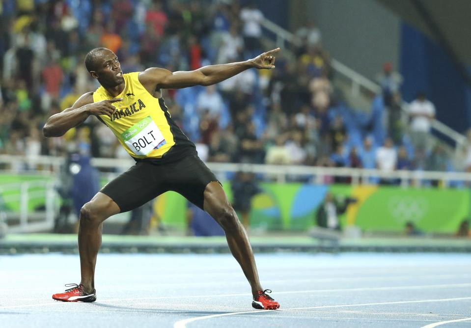 2016 Rio Olympics - Athletics - Final - Men's 200m Final - Olympic Stadium - Rio de Janeiro, Brazil - 18/08/2016. Usain Bolt (JAM) of Jamaica poses after winning the gold.    REUTERS/Lucy Nicholson TPX IMAGES OF THE DAY. FOR EDITORIAL USE ONLY. NOT FOR SALE FOR MARKETING OR ADVERTISING CAMPAIGNS.