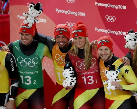 Luge - Pyeongchang 2018 Winter Olympic Games - Team Relay - Pyeongchang, South Korea - February 15, 2018 - Gold medalists Natalie Geisenberger, Johannes Ludwig, Tobias Wendl and Tobias Arlt of Germany during the victory ceremony. REUTERS/Arnd Wiegmann