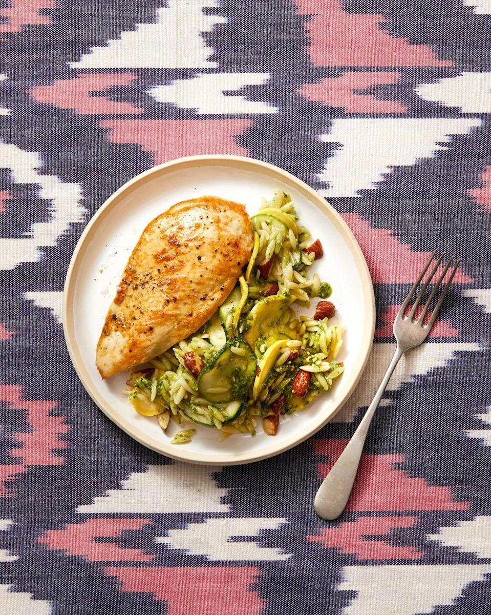 """<p>A side salad full of orzo and fresh veggies perfectly complements this golden-brown seared chicken. <br></p><p><em><a href=""""https://www.goodhousekeeping.com/food-recipes/a28611486/seared-chicken-with-pesto-zucchini-orzo-recipe/"""" rel=""""nofollow noopener"""" target=""""_blank"""" data-ylk=""""slk:Get the recipe for Seared Chicken with Pesto Zucchini Orzo »"""" class=""""link rapid-noclick-resp"""">Get the recipe for Seared Chicken with Pesto Zucchini Orzo »</a></em></p><p><strong>RELATED: </strong><a href=""""https://www.goodhousekeeping.com/food-recipes/healthy/g4056/healthy-chicken-dinners/"""" rel=""""nofollow noopener"""" target=""""_blank"""" data-ylk=""""slk:50 Healthy Chicken Dinners for the Best Weeknights Ever"""" class=""""link rapid-noclick-resp"""">50 Healthy Chicken Dinners for the Best Weeknights Ever</a><br></p>"""