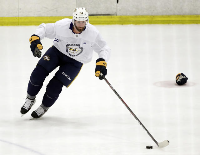 Nashville Predators left wing Austin Watson skates with the puck during NHL hockey training camp Saturday, Sept. 15, 2018, in Nashville, Tenn. Watson has been suspended 27 games without pay by the NHL because of a domestic assault charge. (AP Photo/Mark Humphrey)