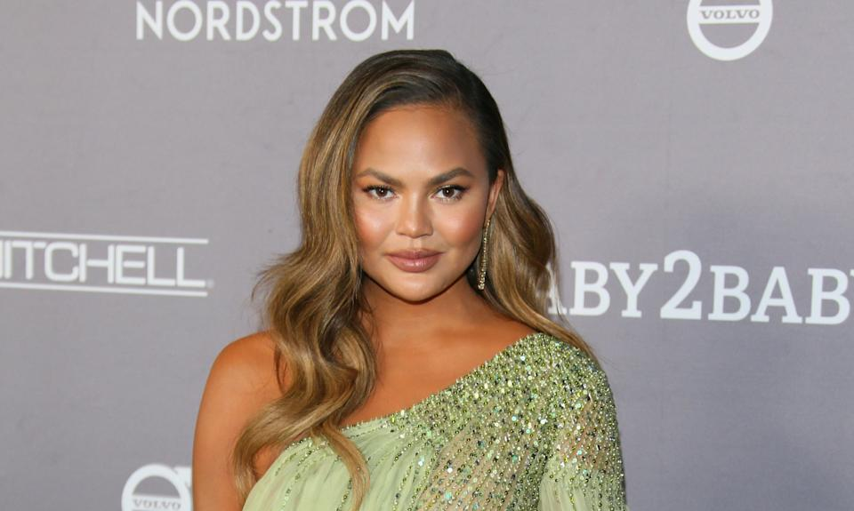 Chrissy Teigen clarifies tweet about learning to horseback ride  (AFP via Getty Images)