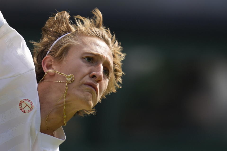 Sebastian Korda of the US serves to Britain's Daniel Evans during the men's singles third round match on day five of the Wimbledon Tennis Championships in London, Friday July 2, 2021. (AP Photo/Kirsty Wigglesworth)