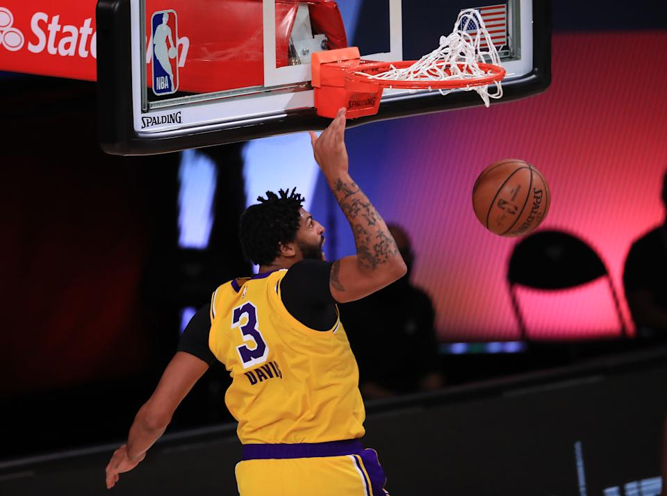 Anthony Davis dunks two of his game-high 29 points for the Lakers on Thursday. (Michael Reaves/Getty Images)