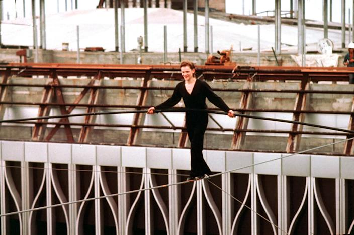 French aerialist Philippe Petit walks on a cable suspended between the not-yet-completed twin towers of the World Trade Center in lower Manhattan, Aug. 7, 1974. After rigging a wire across the 140-foot gap during the night, Petit, 25, stepped onto the cable at 7 a.m. with his balancing pole and walked back and forth as a crowd watched from the streets below. (AP Photo)