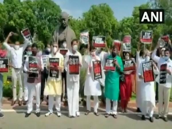 MPs protest at Parliament premises demanding GST payments to states. Photo/ANI