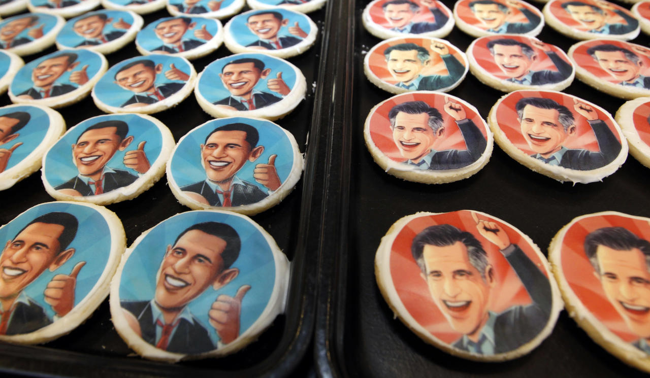 Platters of sugar cookies bearing the likenesses of President Barack Obama, left, and Republican presidential candidate Mitt Romney, are available for sale on the counter at the Oakmont Bakery on Wednesday, Oct. 17, 2012 in Oakmont, Pa. (AP Photo/Keith Srakocic)