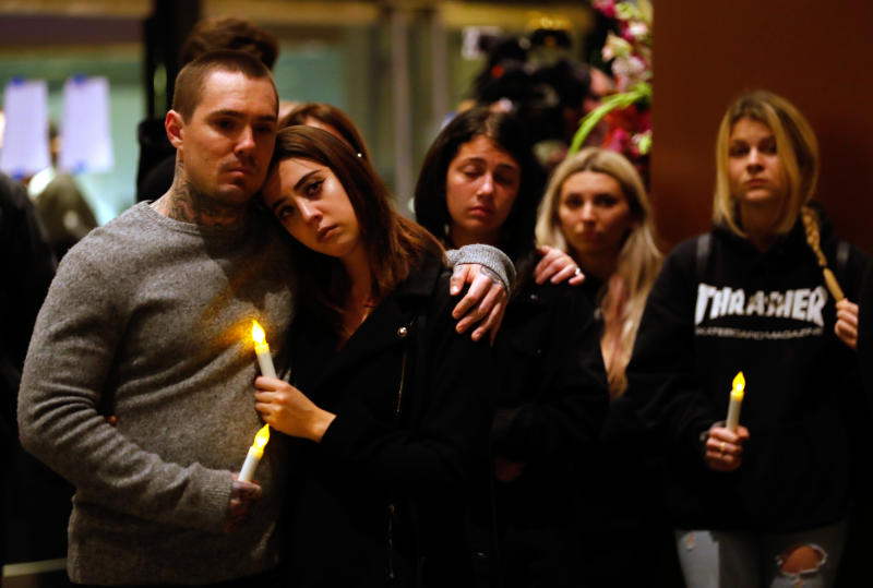 Mourners attend a vigil in Thousand Oaks, California, for the victims of the mass shooting. (Mike Blake / Reuters)