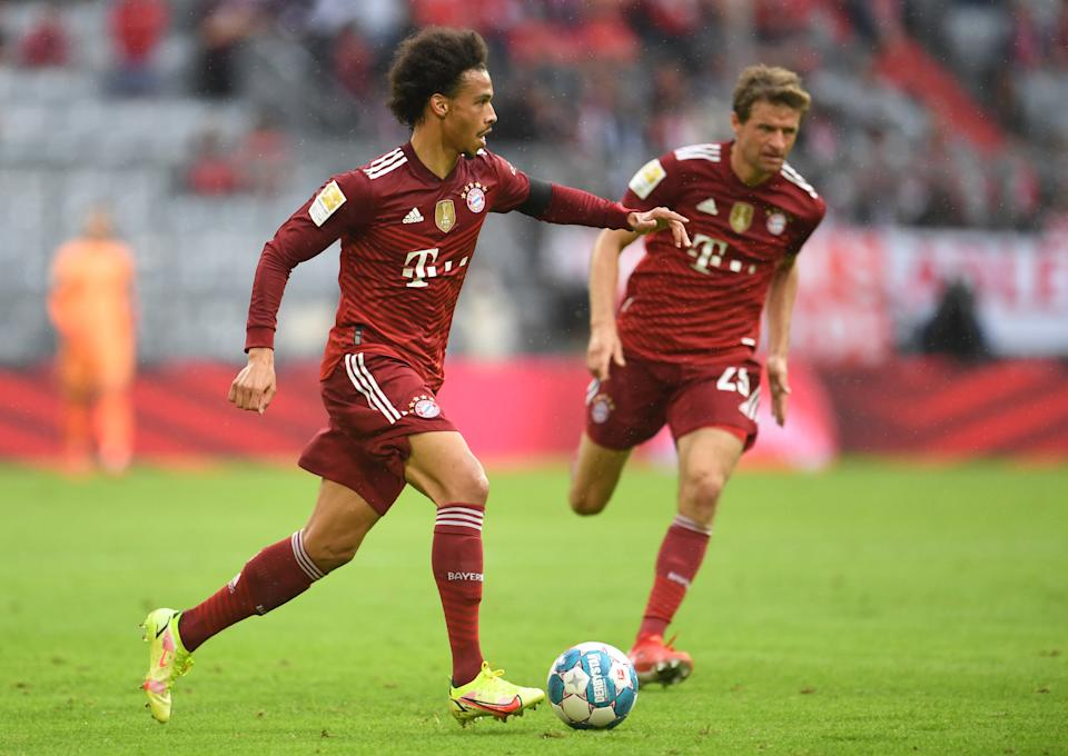 Soccer Football - Bundesliga - Bayern Munich v FC Cologne - Allianz Arena, Munich, Germany - August 22, 2021   Bayern Munich's Leroy Sane and Thomas Muller in action REUTERS/Andreas Gebert DFL regulations prohibit any use of photographs as image sequences and/or quasi-video.