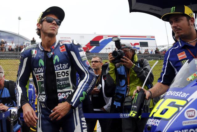Yamaha Moto GP rider Valentino Rossi prepares for the German Grand Prix at the Sachsenring circuit in the eastern German town of Hohenstein-Ernstthal July 13, 2014. REUTERS/Thomas Peter (GERMANY - Tags: SPORT MOTORSPORT)