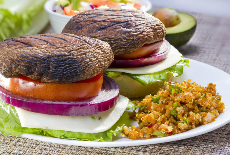 <p>Substitute your beef patty with a lightly seasoned Portobello. This will cut down the fat content dramatically without compromising taste. <i>(Photo Credit: Getty Images)</i></p>