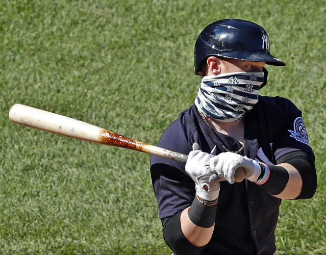 The Yankees' Clint Frazier wears a mask even while hitting during summer camp, a practice he said he will follow throughout the 2020 season. (AP Photo/Kathy Willens)