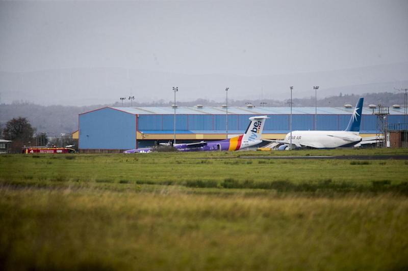 Flybe said one passenger was taken to hospital with a minor hand injury (PA)