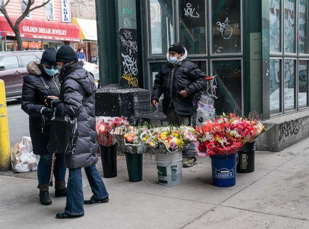 PHOTO: A vendor sells flowers for Valentines Day on the street in Kingsbridge section of the Bronx in New York on Feb. 13, 2021. (Lev Radin/Sipa USA via AP, FILE)