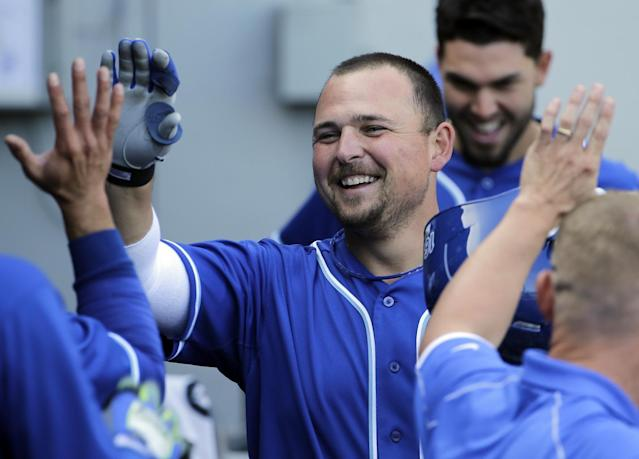 Kansas City Royals' Billy Butler smiles as he celebrates with teammates in the dugout after hitting a 2-run home run during the ninth inning of a baseball game against the Chicago White Sox in Chicago on Saturday, June 14, 2014. (AP Photo/Nam Y. Huh)
