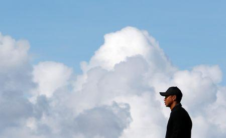 FILE PHOTO: Tiger Woods of the U.S. stands on the 12th green during a practice round ahead of the British Open Championship at the Royal Liverpool Golf Club in Hoylake, northern England July 15, 2014. REUTERS/Stefan Wermuth/File Photo Picture Supplied by Action Images