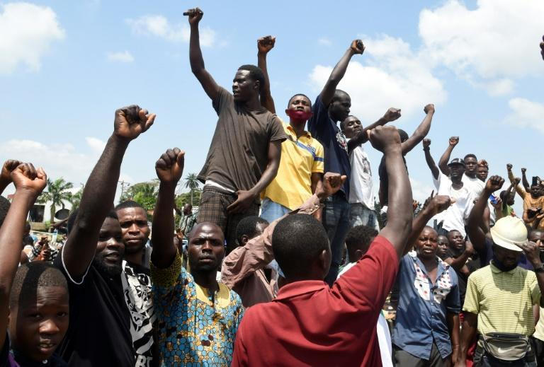 Protesters chant and sing solidarity songs as they barricade the Lagos-Ibadan expressway to protest against police brutality and the killing of protesters by the military, at Magboro, Ogun State