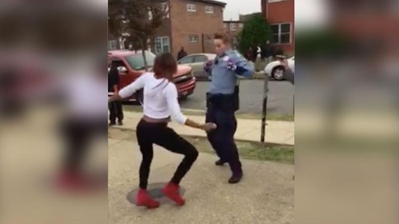 A cop managed to break up a fight between teenagers by calling out a young girl to a dance off. Photo: Facebook/Adore Liyah