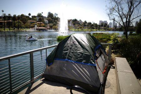 FILE PHOTO: A tent is seen next to Echo Park Lake in Los Angeles, California, U.S. April 11, 2018. REUTERS/Lucy Nicholson