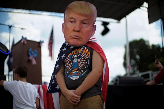 <p>A rally attendee wears a mask depicting the face of U.S. President Donald Trump at the Mother of All Rallies on the National Mall in Washington, Sept. 16, 2017. (Photo: James Lawler Duggan/Reuters) </p>