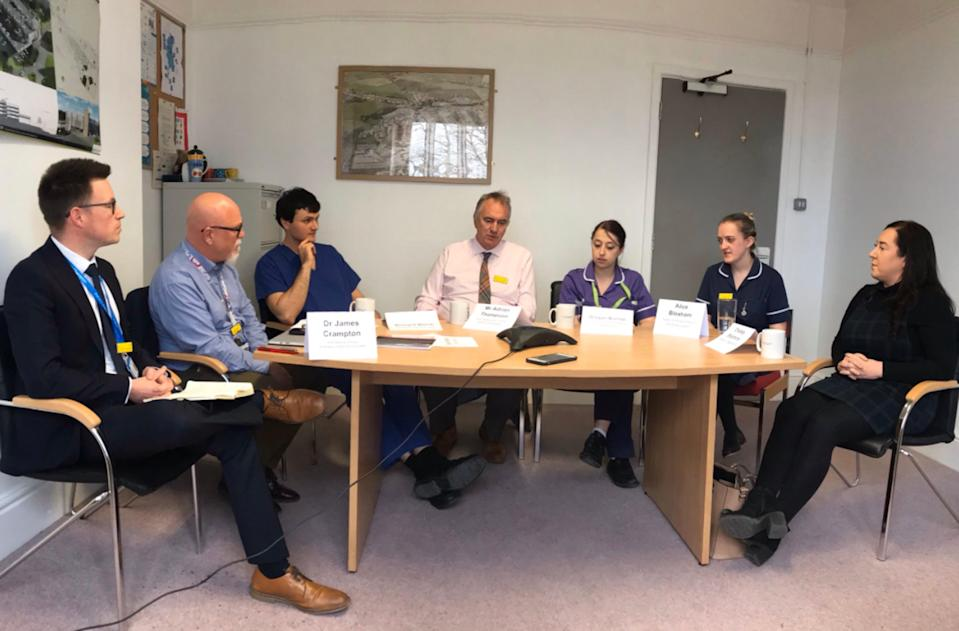 Handout photo issued by QueenÕs Hospital Burton of Staff from the hospital in Staffordshire, where the first frontline NHS worker to die after contracting coronavirus worked, joining in a conversation via telephone speakerphone with the Duke and Duchess of Cambridge on Wednesday. (left to right) Dr James Crampton, QueenÕs Hospital Medical Director, Gavin Boyle, Chief Executive of University Hospitals Derby and Burton NHS Foundation Trust, Richard Welch, ITU staff nurse, Mr Adrian Thompson, Ear, Nose and Throat (ENT) Consultant, Brogan Bishop, newly qualified staff nurse in the Emergency Department, Alice Bloxham, Sister on Ward 4, Covid-19 cohort ward, Chelsey Stephens, Staff nurse in Paediatrics.