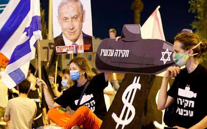 Israeli protesters take part in an anti-government demonstration outside the Ben Gurion Airport near Tel Aviv - Jack Guez