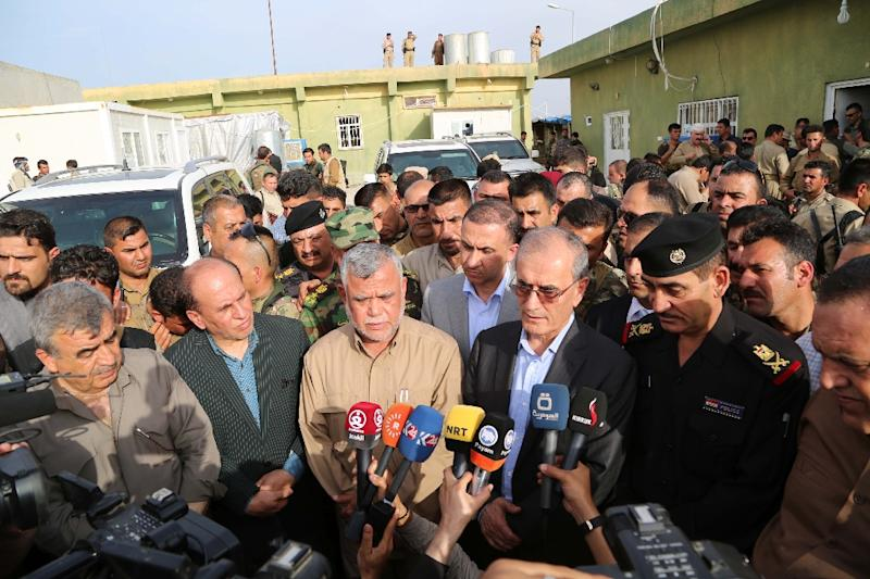 Kirkuk provincial Governor, Najm al-Din Karim and Hadi al-Amiri, who is in charge of the Shiite Muslim Badr Brigades, speak to the press during the laters visit to the northern Iraqi town of Tuz Khurmatu on April 24, 2016 (AFP Photo/Marwan Ibrahim)