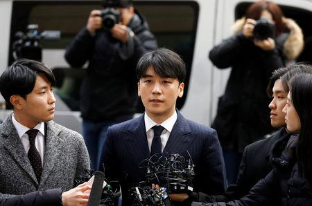 Seungri, a member of South Korean K-pop band Big Bang, arrives to be questioned over a sex bribery case at the Seoul Metropolitan Police Agency in Seoul, South Korea, March 14, 2019.   REUTERS/Kim Hong-Ji