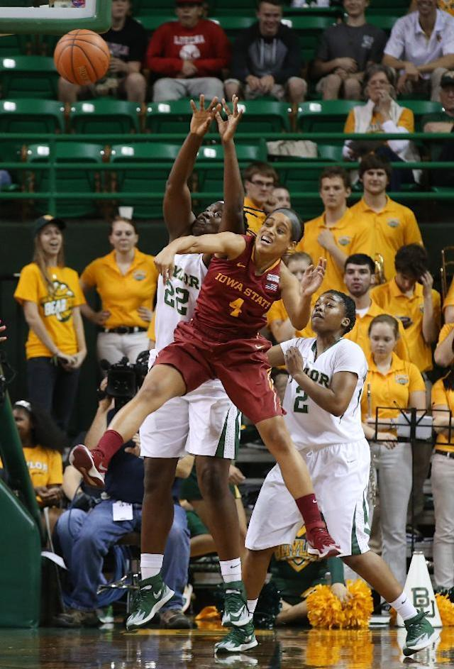 Iowa State guard Nikki Moody (4) battles Baylor center Sune Agbuke (22), left, and guard Niya Johnson (2), right, for a loose rebound in the second half of an NCAA college basketball game, Wednesday, Feb. 19, 2014, in Waco, Texas. (AP Photo/Rod Aydelotte)