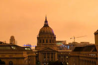 San Francisco City Hall is shrouded in smoke from multiple wildfires burning in the Sierra Nevada and Coast Ranges of Northern California, Wednesday morning, Sept. 9, 2020. Air quality throughout the West was heavily impacted. (AP Photo/Olga Rodriguez)