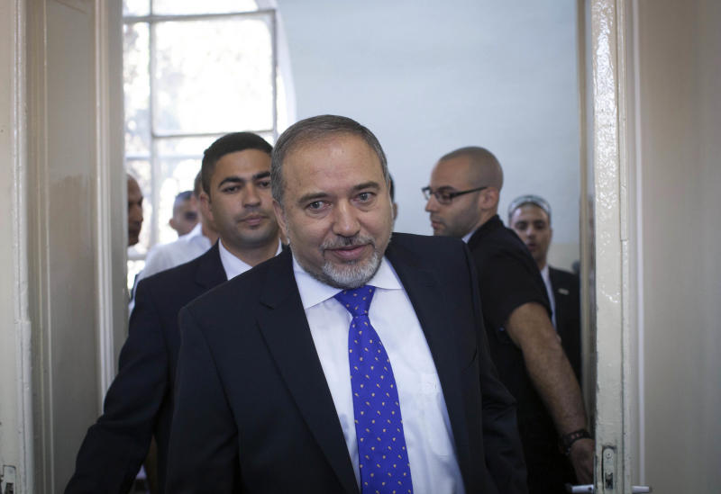 Former Israeli Foreign Minister Avigdor Lieberman arrives in the courtroom before hearing the verdict in his trial on Wednesday, Nov. 6, 2013, at the Magistrates Court in Jerusalem. The Israeli court on Wednesday found Lieberman innocent of all charges in the graft trial, clearing the way for the powerful hard-line politician to return to his post as the nation's top diplomat. (AP Photo/Emil Salman, Pool)