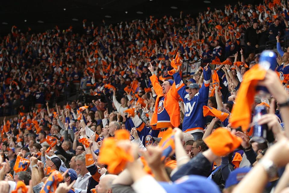Fans celebrate a goal by New York Islanders center Mathew Barzal against the Boston Bruins during the third period of Game 3 of the second round of the 2021 Stanley Cup Playoffs at Nassau Veterans Memorial Coliseum.
