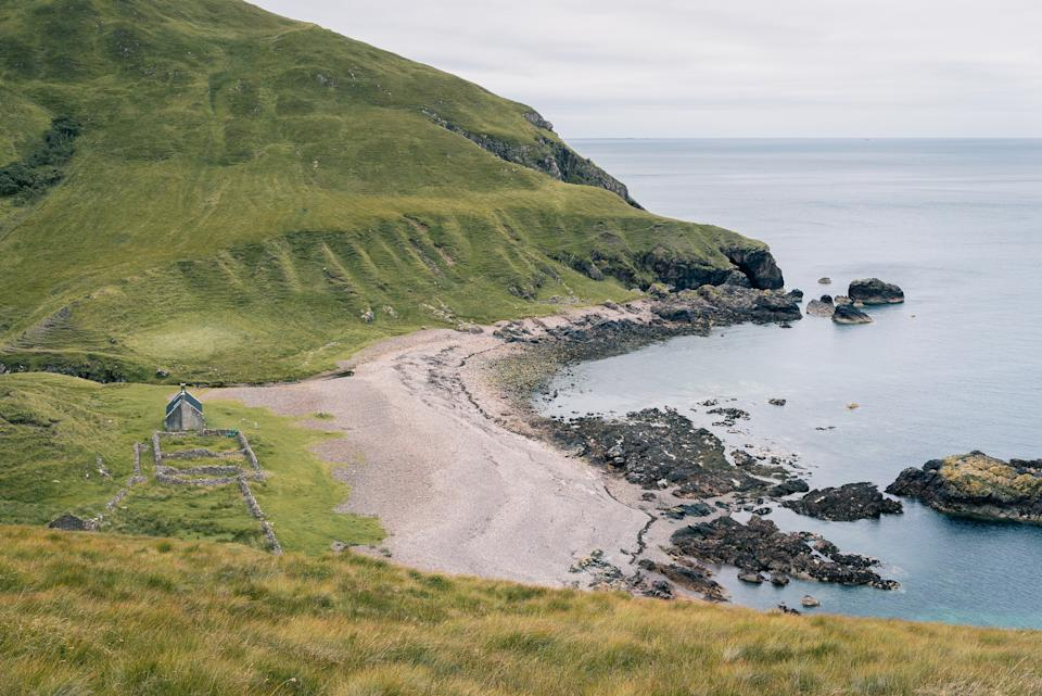 SCOTLAND, August 2019: The Guirdil bothy at the western coastline of the Isle of Rum, a small island at the West Coast of Scotland (Scottish Highlands).
