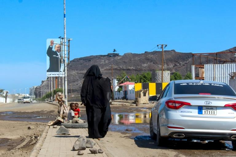 A woman begs for money on the street of the southern Yemeni city of Aden where five new coronavirus cases were reported on Wednesday bringing the total of confirmed cases to six