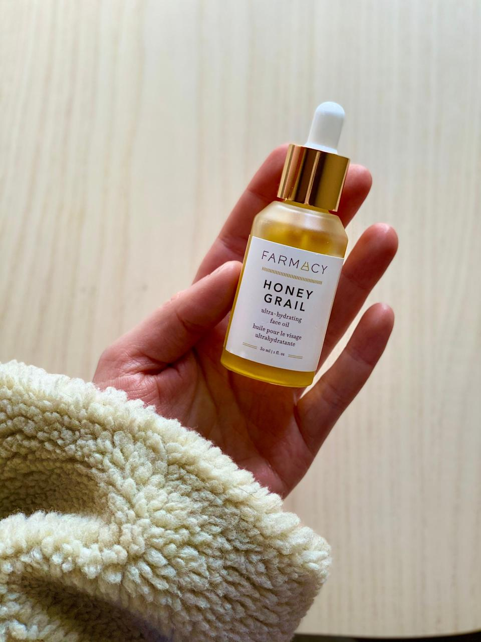 """<h2>Farmacy Honey Grail Ultra-Hydrating Face Oil</h2><br>""""I have sensitive skin (eczema-prone, easily flushed, struggled with perioral dermatitis for five years) — so when I find a product that actually harmonizes with my complexion instead of traumatizing it, it's a good day. I'd had Farmacy's all-natural skincare on my radar but had yet to actually try any of its premium products until Honey Grail. And, it's just as divine as its clever name suggests. It's pretty spot-on described as a """"fast-absorbing, antioxidant-rich face oil for ultimate hydration and glow!"""" The little bottle features a serum-like dropper that dispenses a luxe oil that feels and smells like a lightweight version of honey — likely due to the fact that it's made with real honey, along with sea buckthorn and a five-flower oil blend (including omegas, vitamins, and amino acids). Since I've been using it in the mornings after splashing my face with cool water, I've noticed improvements; my complexion feels plumper, smoother, brighter, and, most importantly, soothed! A little goes a long way and I've got plans to lean on this product as a sensitive-winter-skin holy grail (or, should I say honey grail?)."""" <em>– Elizabeth Buxton, Editor</em><br><br><em>Shop <strong><a href=""""https://www.farmacybeauty.com/products/honey-grail"""" rel=""""nofollow noopener"""" target=""""_blank"""" data-ylk=""""slk:Farmacy"""" class=""""link rapid-noclick-resp"""">Farmacy</a></strong></em><br><br><strong>Farmacy</strong> Honey Grail, $, available at <a href=""""https://go.skimresources.com/?id=30283X879131&url=https%3A%2F%2Fwww.farmacybeauty.com%2Fproducts%2Fhoney-grail"""" rel=""""nofollow noopener"""" target=""""_blank"""" data-ylk=""""slk:Farmacy"""" class=""""link rapid-noclick-resp"""">Farmacy</a>"""