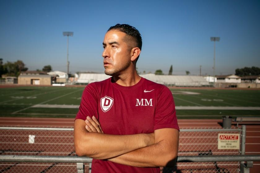 Downey High soccer coach Marvin Mires poses Oct. 30, 2020.