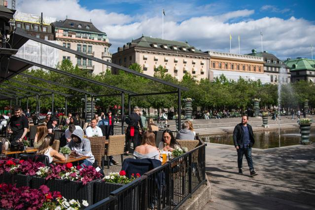 People sit at a restaurant in Stockholm, Sweden's capital. (Getty)