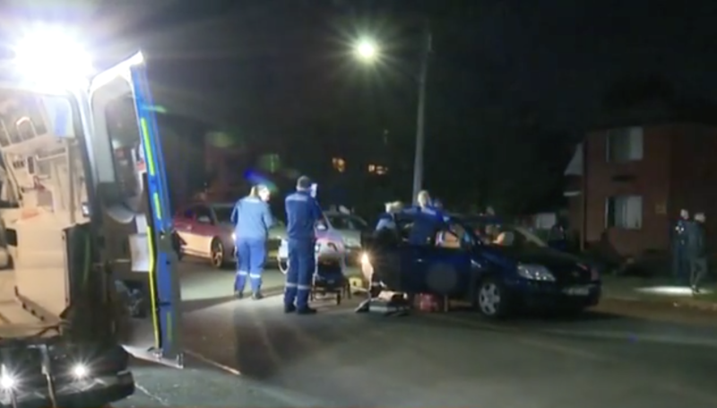 An 18-year-old had to be taken to hospital after being pinned between two cars. Source: Sunrise