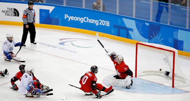 Ice Hockey - Pyeongchang 2018 Winter Paralympics - Gold Medal Game - Canada v U.S. - Gangneung Hockey Centre, Gangneung, South Korea - March 18, 2018 - Declan Farmer of the U.S. (16) scores the winning goal. REUTERS/Carl Recine TPX IMAGES OF THE DAY