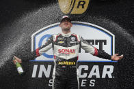 Rinus VeeKay, of the Netherlands, celebrates after winning the IndyCar auto race at Indianapolis Motor Speedway, Saturday, May 15, 2021, in Indianapolis. (AP Photo/Darron Cummings)