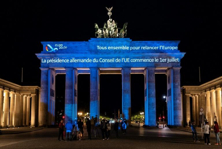 """Germany kicked off its EU custodianship by projecting the words """"Together for Europe's recovery"""" onto Berlin's iconic Brandenburg Gate (AFP Photo/John MACDOUGALL)"""