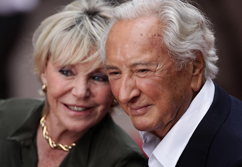Michael Winner and Geraldine Lynton Edwards arriving for the UK premiere of The Expendables at the Odeon, Leicester Square, London.Picture date: Monday August 9, 2010. (Photo by Yui Mok/PA Images via Getty Images)